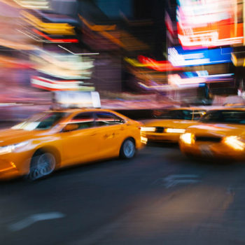 Blurred Scene of Yellow Taxis in Manhattan, New York